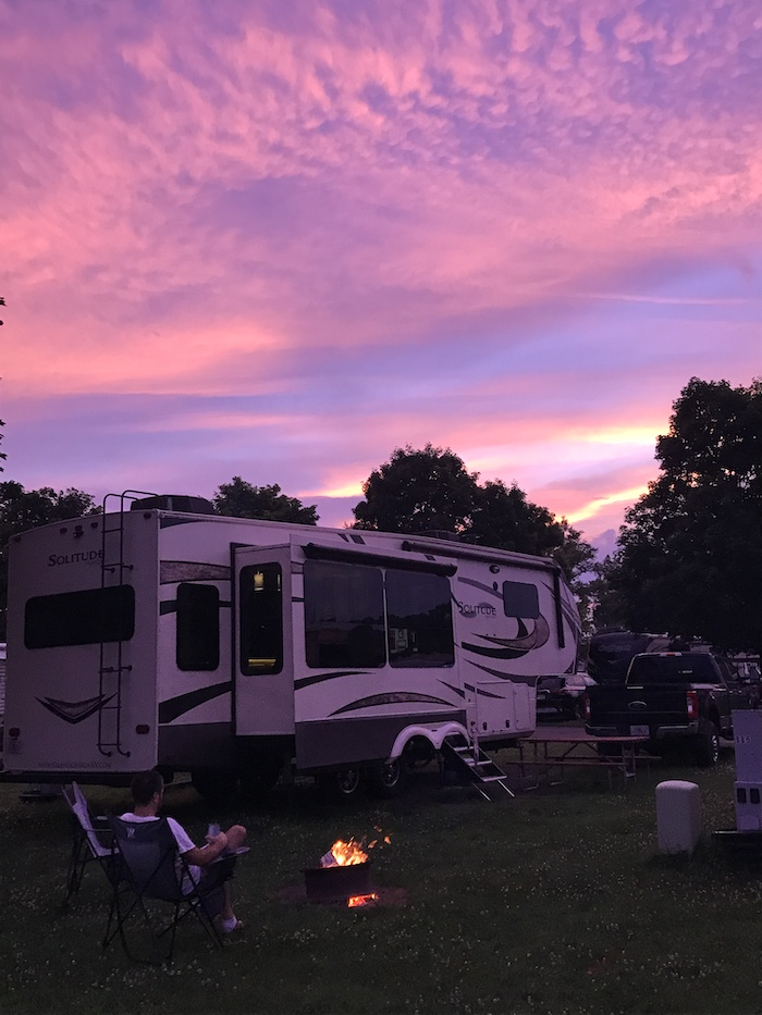 camper and a gorgeous pink and purple sunset