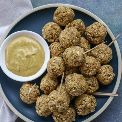 Lentil Sausage and Vegan Cheese Balls on a plate